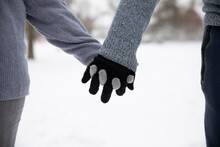Couple With Gloves Holding Hands During Winter