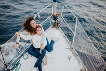 Happy Mother And Daughter Enjoying Navigation On The Sea In A Sail Boat In Barcelona Spain