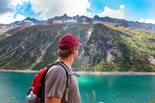 Mature Man Looking Away By Lake At Zillergrund, Austria