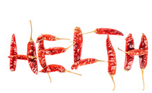 The Word Health Is Laid Out From Pungent Dry Pepper Pods On A White Background.