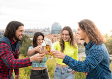 Long Haired Men With Women Toasting Beer Bottles