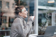 Happy Businesswoman With Coffee Cup At Cafe