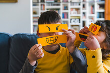 Girl And Boy Playing With Emoticons At Home