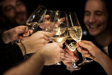 Happy Male And Female Friends Toasting Glasses During Celebration At Home