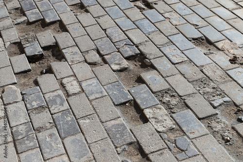Canvastavla Old damaged cobbled road, concrete street pavement