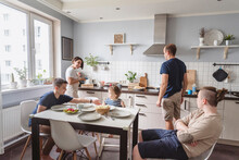 Happy Family In Kitchen At Home
