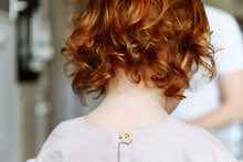 Girl With Red Hair At Home