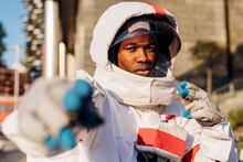 Male Astronaut Wearing Space Helmet Gesturing