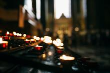Candles Igniting In Dark Church