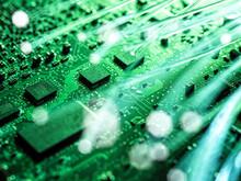 Fibre Optics Carrying Data Being Transferred To Desktop Computer