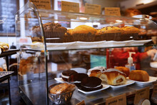 Cakes And Muffins Displayed Inside Bakery