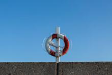 Denmark, Romo, Life Belt Hanging Against Clear Sky