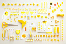 Collection Of Yellow Items Including Flower Heads, Sewing Items And Office Supplies