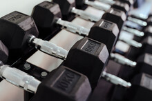 Heavy Dumbbells In A Line At Health Club