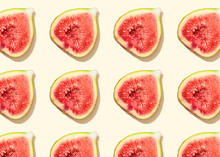 Pattern Of Halved Figs Flat Laid Against Light Yellow Background