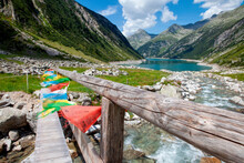 Colorful Cloths Hanging On Wooden Railing At Zillertal, Austria