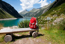 Backpack On Wooden Bench During Sunny Day At Zillertal, Austria