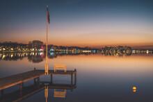 Germany, Schleswig-Holstein, Heiligenhafen, Lakeshore Jetty At Dusk With Town In Background