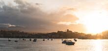Spain, Cantabria, San Vicente De La Barquera, Boats In Sea At Sunset