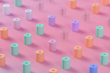 Three Dimensional Pattern Of Pastel Colored Cylinders Standing Against Pink Background