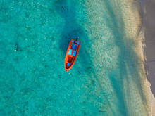 Aerial View Of Red Boat Floating On Turquoise Water Of Kaafu Atoll, Maldives