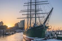 Germany, Hamburg, Museum Ship Rickmer Rickmers At Sunrise With Elbe Philharmonic Hall In Background