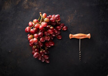 Studio Shot Of Fresh Red Grapes And Corkscrew