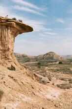 Sandstone Rock Formation In Monegros Desert With Hills In Background