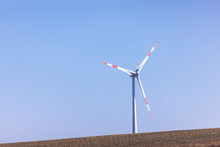 Wind Turbine Standing Against Clear Blue Sky