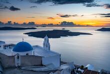 Greece, Santorini, Fira, Anastasi Orthodox Church At Dusk With Aegean Sea In Background