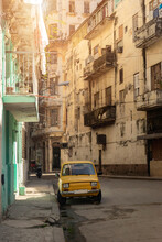 Vintage Yellow Car Parking In The Street In Havanna