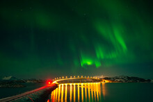 Norway, Tromso, Sommaroy, Northern Lights Over Illuminated Bridge