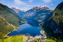 Norway, More Og Romsdal, Scenic View Of Secluded Village In Geiranger Fjord