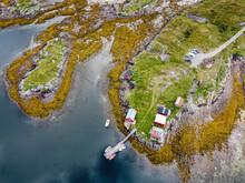 Norway, Vega Archipelago, Aerial Of Boat Sheds On Rugged Coastline Of Unesco World Heritage Site