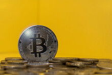 Silver Colored Bitcoin Among Coins
