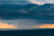 Gray Rain Clouds Over Pacific Ocean At Dusk