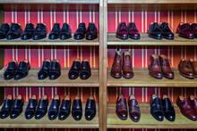 Variations Of Leather Shoes On Wooden Shelf At Workshop