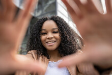 Cheerful Black Woman Showing Hands To Camera