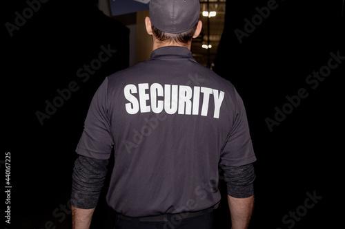 Closeup shot of a security guard in uniform patrolling in a commercial mall Fototapeta