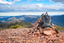 Backpack Leaning On A Cairn Of Stones At The Top Of Vallières-de-Saint-Réal Mountains, Gaspésie, Quebec, Canada