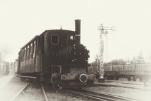 A Photo Of The Narrow-gauge Railway, Stylized As An Old Photograph