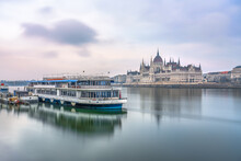 Hungarian Parliament At Sunrise In Budapest. Long Exposure
