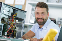 Smiling Young Electronics Technician At Work