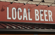 Local Beer Sign On Brick Wall Rural Cafe Sign