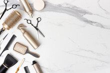 Hair Cutting Tools And Accessories On Marble Background With Space
