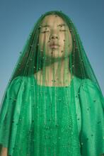 Asian Girl With Green Veil Under Blue Sky Like Virgin Mary Statue
