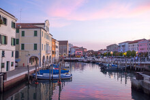 Chioggia, Italy, City On The Water At Sunset