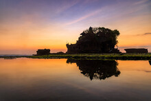 Silhouette Of Tanah Lot Temple In Golden Sunset It The Most Attraction And Travel Destination Of Bali, Indonesia.