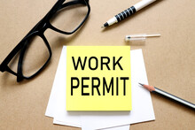 Work Permit. The Inscription On The Business Card Is Attached To The Notebook.