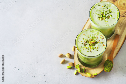 Fotografie, Obraz Green matcha latte with pistachios and matcha powder